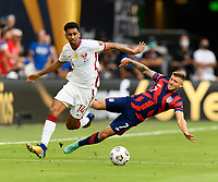 AUSTIN, TX - JULY 29: Paul Arriola #7 of the United States is knocked off his feet by Homam Ahmed #14 of Qatar during a game between Qatar and USMNT at Q2 Stadium on July 29, 2021 in Austin, Texas.