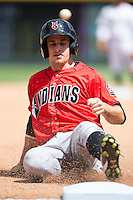 Max Moroff (2) of the Indianapolis Indians slides into third base during the game against the \cl\ at BB&T BallPark on June 19, 2016 in Charlotte, North Carolina.  The Indians defeated the Knights 6-3.  (Brian Westerholt/Four Seam Images)