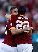 Calcio, Serie A: Roma vs ChievoVerona. Roma, stadio Olimpico, 18 ottobre 2014.<br /> Roma's Mattia Destro celebrates with teammate Francesco Totti, left, after scoring during the Italian Serie A football match between Roma and ChievoVerona at Rome's Olympic stadium, 18 October 2014.<br /> UPDATE IMAGES PRESS/Isabella Bonotto
