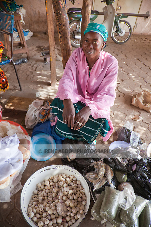 A woman sells garlic and bread in the marketplace in Segou, Mali.