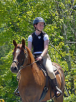 Young woman on horseback in parade for July 4th events