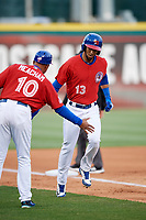 Buffalo Bisons shortstop Lourdes Gurriel Jr. (13) is congratulated by manager Bobby Meacham (10) as he rounds third base after hitting a grand slam home run in the bottom of the fourth inning during a game against the Scranton/Wilkes-Barre RailRiders on May 18, 2018 at Coca-Cola Field in Buffalo, New York.  Buffalo defeated Scranton/Wilkes-Barre 5-1.  (Mike Janes/Four Seam Images)