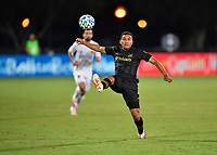 LAKE BUENA VISTA, FL - JULY 18: Eddie Segura #4 of LAFC reaches to settle a ball during a game between Los Angeles Galaxy and Los Angeles FC at ESPN Wide World of Sports on July 18, 2020 in Lake Buena Vista, Florida.
