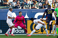 CARSON, CA - JUNE 19: Yeimar Gomez Andrade #28 of the Seattle Sounders FC heads a ball past Jonathan Bond #1 of the Los Angeles Galaxy for a goal during a game between Seattle Sounders FC and Los Angeles Galaxy at Dignity Health Sports Park on June 19, 2021 in Carson, California.
