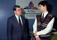 Jean Allaire (L), leader<br /> Mario Dumont (R)<br /> Action démocratique du Québec (ADQ)<br /> in March 1994<br /> <br /> This party was founded in 1994 by Québec LIBERAL PARTY dissidents. After the rejection of the CHARLOTTETOWN ACCORD in October 1992, Mario Dumont, leader of the Young Liberals of Québec, and Jean Allaire a member of the executive committee of the Québec Liberal Party, left the Liberal Party when its members decided not to defend their platform proposition of 22 fields of exclusive jurisdiction claimed on behalf of Québec.<br /> <br /> The dissidents formed an initial amalgamation, le groupe de Réflexion Québec, followed in December 1993 by Action Québec. The (ADQ) party was founded only the following year, placing Mario Dumont, 23, the youngest party leader in Québec, at its head. The ADQ presented its first electoral platform on 5 and 6 March 1994, when 612 delegates from all the Québec regions adopted a Plan national de redressement (National recovery plan), bearing some twenty propositions aimed at elaborating an economic strategy and stabilizing government finances.<br /> <br /> In the September 1994 elections, the ADQ elected only a single candidate, Mario Dumont, in Rivière-du-Loup, but still obtained nearly 10 percent support of Quebec voters, even if it did not present candidates in all the electoral districts.<br /> <br /> In June 1995, Mario Dumont, Lucien BOUCHARD, then leader of the BLOC QUÈBÈCOIS, and Jacques PARIZEAU, leader of the PARTI QUÈBECOIS, signed an agreement that united these three parties within the Yes camp and partnered them for the formulation of the referendum question (see QUÈBEC REFERENDUM 1995).<br /> <br /> In the 30 November 1998 elections, only Mario Dumont was elected, again in Rivière-du-Loup, if the ADQ increased its percentage of support, by about 500 000 votes. The ADQ did not succeed in passing the critical voting threshold of 15 percent, making it a third party. However, the ADQ fought for proportional re