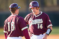 Rob Kral #14 of the College of Charleston Cougars chats with his first base coach during the game against the Davidson Wildcats at Wilson Field on March 12, 2011 in Davidson, North Carolina.  The Wildcats defeated the Cougars 8-3.  Photo by Brian Westerholt / Four Seam Images