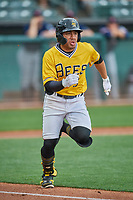 Kean Wong (5) of the Salt Lake Bees hustles to first base during the game against the Tacoma Rainiers at Smith's Ballpark on May 16, 2021 in Salt Lake City, Utah. The Bees defeated the Rainiers 8-7. (Stephen Smith/Four Seam Images)