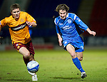 St Johnstone v Motherwell....26.01.11  .Stevie May is tracked by Shaun Hutchinson.Picture by Graeme Hart..Copyright Perthshire Picture Agency.Tel: 01738 623350  Mobile: 07990 594431