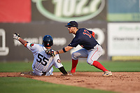 Lowell Spinners shortstop Korby Batesole (12) tags Daniel Reyes (55) as he slides into second base during a game against the Connecticut Tigers on August 26, 2018 at Dodd Stadium in Norwich, Connecticut.  Connecticut defeated Lowell 11-3.  (Mike Janes/Four Seam Images)