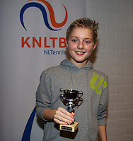 November 30, 2014, Almere, Tennis, Winter Youth Circuit, WJC,  Prizegiving,  Xander Temmng 8th place<br /> Photo: Henk Koster