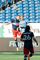 FOXBOROUGH, MA - SEPTEMBER 19: Alexander Buttner #28 of New England Revolution and Gary Mackay-Steven #17 of New York City FC compete for a high ball during a game between New York City FC and New England Revolution at Gillette on September 19, 2020 in Foxborough, Massachusetts.
