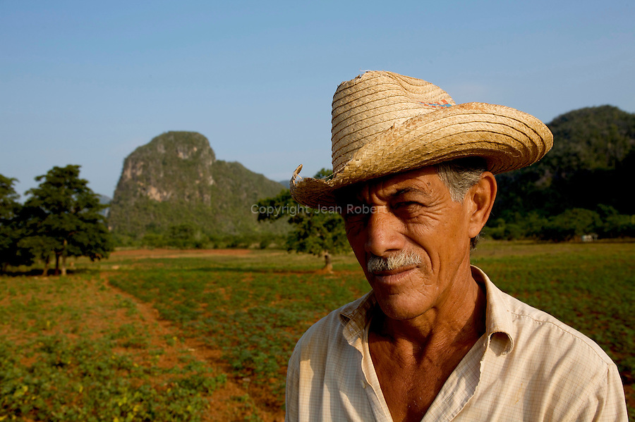 Tobacco farmer in Viñales Valley (Spanish: Valle de Viñales. The conspicuous cliffs rising like islands from the bottom of the valley are called mogotes.