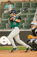 Juan Perez #33 of the Augusta GreenJackets follows through on his swing versus the Kannapolis Intimidators at Fieldcrest Cannon Stadium July 24, 2009 in Kannapolis, North Carolina. (Photo by Brian Westerholt / Four Seam Images)
