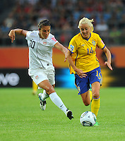 Carli Lloyd (l) of team USA and Josefine Oqvist of team Sweden during the FIFA Women's World Cup at the FIFA Stadium in Wolfsburg, Germany on July 6thd, 2011.