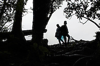 Tourists in the forests near to the Hailuogou glacier in western Sichuan Province, China. As a result of rising temperatures on the Tibetan Plateau, the Hailuogou glacier has retreated over 2 km during the 20th century alone. Since the Little Ice Age, studies have revealed that the total monsoonal glacier coverage in the southeast of the Tibetan Plateau has decreased by as much as 30 percent, causing alarm in scientific circles.