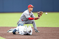 Rutgers Scarlet Knights shortstop Kevin Welsh (2) waits for a throw as Michigan Wolverines baserunner Jack Blomgren (2) slides into second base on April 27, 2019 in the NCAA baseball game at Ray Fisher Stadium in Ann Arbor, Michigan. Michigan defeated Rutgers 10-1. (Andrew Woolley/Four Seam Images)