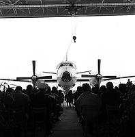 """cérémonie de baptême de l'avion militaire """"Bréguet 1150 Atlantic"""" destiné aux forces de l'OTAN en présence de M. Pierre Mesmer (ministre de la Guerre) et de son épouse (marraine de l'avion),le  3 novembre 1961. aux Ateliers Bréguet (Colomiers)<br /> <br /> <br /> : au 1er plan vue de dos des invités assis ; en arrière-plan vue de face du Bréguet stationné dans l'entrée du hangar."""