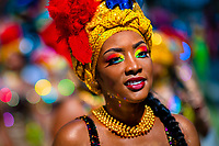 An Afro-Colombian dancer of the La Yesquita neighborhood takes part in the San Pacho festival in Quibdó, Colombia, 30 September 2019. Every year at the turn of September and October, the capital of the Pacific region of Chocó holds the celebrations in honor of Saint Francis of Assisi (locally named as San Pacho), recognized as Intangible Cultural Heritage by UNESCO. Each day carnival groups, wearing bright colorful costumes and representing each neighborhood, dance throughout the city, supported by brass bands playing live music. The festival culminates in a traditional boat ride on the Atrato River, followed by massive religious processions, which accent the pillars of Afro-Colombian's identity – the Catholic devotion grown from African roots.