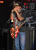 WEST PALM BEACH, FL - AUGUST 05: Aaron Lewis of Staind performs at The iTHINK Financial Amphitheatre on August 5, 2021 in West Palm Beach Florida. Credit Larry Marano © 2021