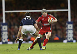 Wales centre Jonathan Davies takes on his opposite number Geoff Cross.<br /> RBS 6 Nations 2014<br /> Wales v Scotland<br /> Millennium Stadium<br /> <br /> 15.03.14<br /> <br /> ©Steve Pope-SPORTINGWALES