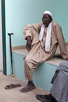 Senegal, Saint Louis.  Senegalese Muslim Man Waiting for Prayer Time at the Mosque.