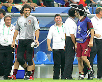 Portugal goalkeeper Quim has a laugh as teammate Luis Figo (7) sports a sombrero thown out of the stands at the end of the game. Portugal defeated Mexico 2-1 in their FIFA World Cup Group D match at FIFA World Cup Stadium, Gelsenkirchen, Germany, June 21, 2006.