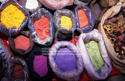 Pisac, Peru. Bags of powdered dyes on sale at the market; used for traditional woven fabrics.