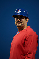 Stockton Ports catcher Jason Goldstein (18) smiles for the camera while coaching first base during a California League game against the Rancho Cucamonga Quakes at Banner Island Ballpark on May 16, 2018 in Stockton, California. Rancho Cucamonga defeated Stockton 6-3. (Zachary Lucy/Four Seam Images)