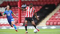 Ethan Pinnock of Brentford in action during Brentford vs Wigan Athletic, Sky Bet EFL Championship Football at Griffin Park on 4th July 2020