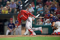 Pawtucket Red Sox pinch hitter Rusney Castillo (38) hits a two run single in front of catcher Cameron Rupp (22) during a game against the Rochester Red Wings on July 4, 2018 at Frontier Field in Rochester, New York.  Pawtucket defeated Rochester 6-5.  (Mike Janes/Four Seam Images)