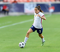 HOUSTON, TX - JUNE 10: Kelley O'Hara #5 of the United States brings the ball up the field during a game between Portugal and USWNT at BBVA Stadium on June 10, 2021 in Houston, Texas.