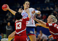 BELGRADE, SERBIA - DECEMBER 16:  Andrea Lekic (C) of Serbia is challenged by Anita Gorbicz (L) of Hungary during the Women's European Handball Championship 2012 third place match between Hungary and Serbia at Arena Hall on December 16, 2012 in Belgrade, Serbia. (Photo by Srdjan Stevanovic/Getty Images) ***Local Caption *** Andrea Lekic;Anita Gorbicz