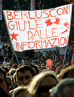 "Manifestazione per la liberta' di informazione, in Piazza del Popolo, Roma, 3 ottobre 2009..A demonstrator holds a banner reading ""Berlusconi put your hands away from informations"" during a rally for media freedom in Rome's Piazza del Popolo, 3 october 2009..UPDATE IMAGES PRESS/Riccardo De Luca"