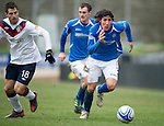 St Johnstone v Rangers...14.01.12  .Fran Sandaza pulls away from Carlos Bocanegra.Picture by Graeme Hart..Copyright Perthshire Picture Agency.Tel: 01738 623350  Mobile: 07990 594431