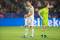 CARSON, CA - SEPTEMBER 15: Zlatan Ibrahimovic #9 of the Los Angeles Galaxy prepares for a penalty kick as Tim Melia #29 of Sporting Kansas City looks on during a game between Sporting Kansas City and Los Angeles Galaxy at Dignity Health Sports Park on September 15, 2019 in Carson, California.