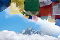 A view of Mount Everest through the prayer flags on Renjo La Pass, Nepal.