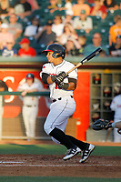 Lansing Lugnuts catcher Andres Sotillo (16) follows through on a swing during a game against the Dayton Dragons at Cooley Law School Stadium on August 10, 2018 in Lansing, Michigan. Lansing defeated Dayton 11-4.  (Robert Gurganus/Four Seam Images)
