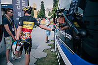 Belgian National Champion Yves Lampaert (BEL/Quick-Step Floors) stretching against the teambus pre-race<br /> <br /> Stage 10: Annecy > Le Grand-Bornand (159km)<br /> <br /> 105th Tour de France 2018<br /> ©kramon