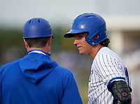Lakeland Christian Vikings Ian Anderson (11) talks with coach Matt Diaz during the IMG National Classic on March 29, 2021 at IMG Academy in Bradenton, Florida.  (Mike Janes/Four Seam Images)