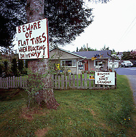Tofino, BC, Vancouver Island, British Columbia, Canada - Humorous Warning Signs in Front of House (No Property Release)