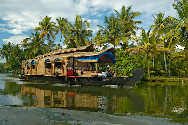 India, Kerala, backwaters. Traditional style houseboat shipping tourists through the Backwaters. No releases available.