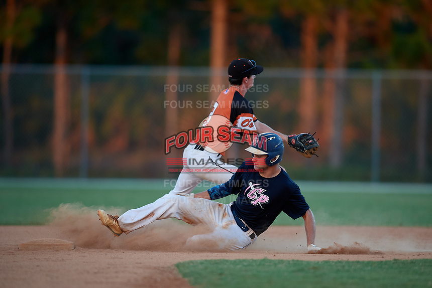 Jacob Bennett slides into second base as Owen Harley fields a throw during the WWBA World Championship at the Roger Dean Complex on October 20, 2018 in Jupiter, Florida.  Jacob Bennett is a catcher from St. Johns, Florida who attends Bartram Trail High School.  (Mike Janes/Four Seam Images)