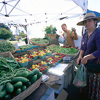 Farmer selling Fruit and Vegetables at the Saturday Market in Ganges, on Saltspring Island, in the Southern Gulf Islands of British Columbia, Canada