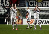 Swansea, UK. Thursday 20 February 2014<br /> Pictured L-R: Swansea players Ben Davies and Wayne Routledge thank home supporters<br /> Re: UEFA Europa League, Swansea City FC v SSC Napoli at the Liberty Stadium, south Wales, UK