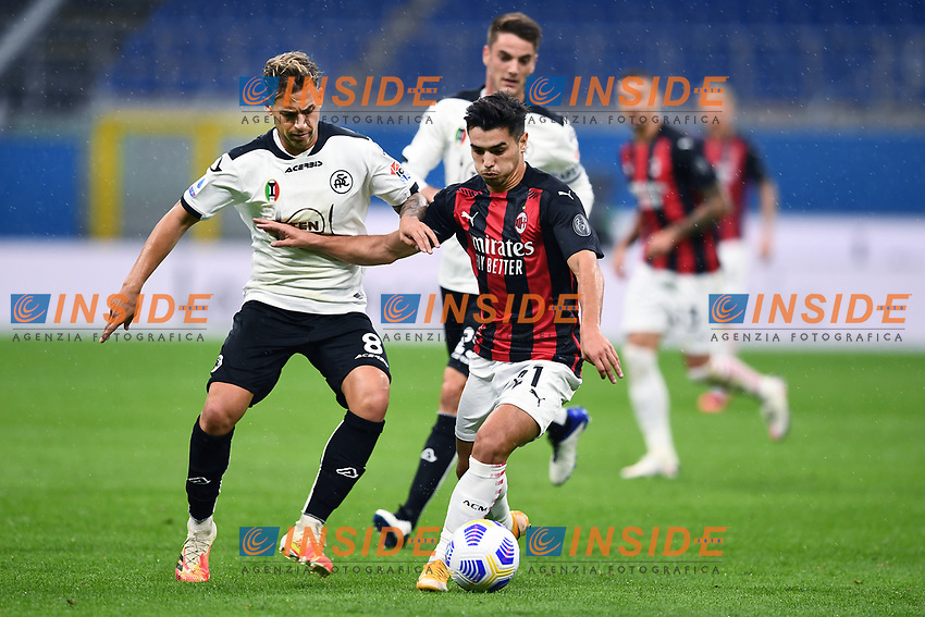 Brahim Diaz of Ac Milan and Matteo Ricci of Spezia compete for the ball during the Serie A football match between AC Milan and Spezia Calcio at San Siro Stadium in Milano  (Italy), October 4th, 2020. Photo Image Sport / Insidefoto