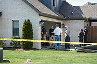 Bentonville police investigate, Thursday, June 3, 2021 the site of a fatal house fire at 3211 SW Riverstone Ave. in Bentonville.  Check out nwaonline.com/210604Daily/ for today's photo gallery. <br /> (NWA Democrat-Gazette/Charlie Kaijo)