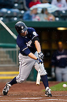 Jamie Romak (26) of the Northwest Arkansas Naturals hits a ground ball during a game against the Springfield Cardinals on May 13, 2011 at Hammons Field in Springfield, Missouri.  Photo By David Welker/Four Seam Images.