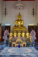 Bangkok, Thailand.  Buddha Statue in the South Pavilion of the Wat Pho (Reclining Buddha) Temple Complex.  The Buddha displays the Bhumisparsha mudra (gesture), calling the earth to witness.