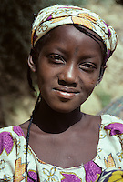 Near Niamey, Niger. A Young Fulani Woman.  Note the S tattoo on the forehead just above the bridge of the nose.