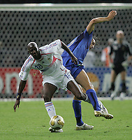 Italian forward (9) Luca Toni collides with French midfielder (18) Alou Diarra.  Italy defeated France on penalty kicks after leaving the score tied, 1-1, in regulation time in the FIFA World Cup final match at Olympic Stadium in Berlin, Germany, July 9, 2006.